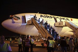 File photo: Passengers exit an Air France plane after it landed at Tehran's Imam Khomeini International Airport, south of the capital Tehran.