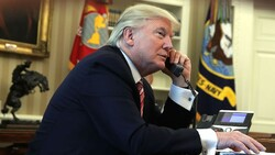 U.S. President Donald Trump speaking on the phone in the Oval Office of the White House in an undated photo.
