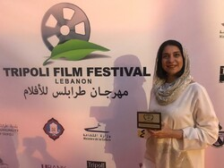 "Director Mona Zandi-Haqiqi accepts a special jury award for her drama ""African Violet"" at the 6th Tripoli Film Festival in Lebanon on June 19, 2019."