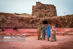 People tour the Portuguese Castle of Hormuz in the Persian Gulf