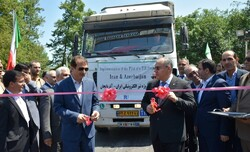 Head of Iran's Customs Administration, Mehdi Mirashrafi, (L) and chairman of Azerbaijan State Customs Committee, Safar Mehdiyev, cut the ribbon at the inaugural ceremony of e-TIR project on June 18