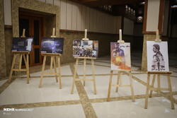 "Posters for ""Twilight: Dark Summer"" are on display during the unveiling of the computer game at Tehran's Vali-e Asr Garrison on June 24, 2019. (Mehr/Asghar Khamseh)"