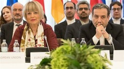 Iranian Deputy Foreign Minister Abbas Araghchi (R) and EU External Action Service Secretary General Helga Schmid (L) take part in a meeting of the Joint Commission of the Joint Comprehensive Plan of Action attended by the E3+2 (China, France, Germany, Russia, the United Kingdom) and Iran at the Palais Coburg in Vienna, Austria, on June 28, 2019. (Photo by AFP)