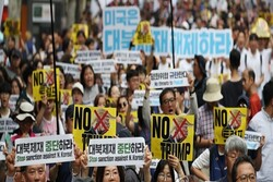 جنوبی کوریا میں کتے کا گوشت کھانے کے خلاف مظاہرہ
