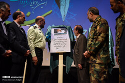 "Military commanders and cultural officials unveil Leader of the Islamic Revolution Ayatollah Seyyed Ali Khamenei's note on the book ""The Lion of Zaytan"" at Tehran's Arasbaran Cultural Center on July 4"