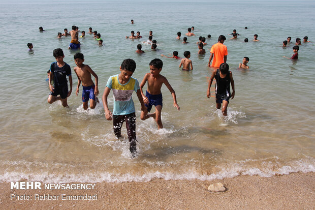 Swimming in Persian Gulf to escape summer heat
