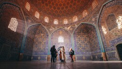 People visit the 17th-century Sheikh Lotfollah Mosque, one of the masterpieces of Iranian architecture in Isfahan.