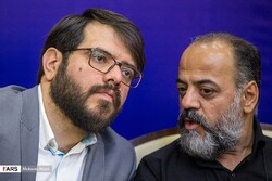 "Producer Mojtaba Amini (L) and director Javad Afshar attend a press conference in Tehran on July 9, 2019 to brief the media about the docudrama ""Gando"" on the espionage case of Jason Rezaian. (Fars/Mo"