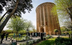 People visit the 12th-cenury Tughrul Tower in Rey, southern Tehran.