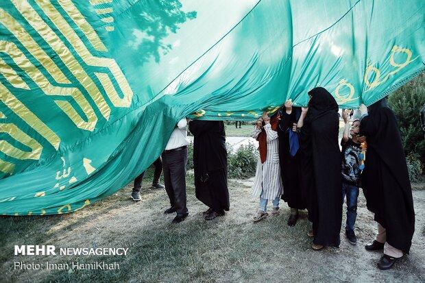 اهتزاز پرچم ۱۴۴ متری امام رضا در پارکمردم همدان