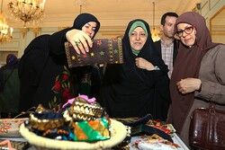 (From left) CHHTO deputy director Pouya Mahmoudian and Vice President for Women's and Family Affairs Masoumeh Ebtekar visit an exhibition of traditional women's wear and personal ornamentation at Tehran's Niavaran Cultural-Historical Complex on July 10, 2019.