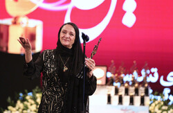 Actress Golab Adineh accepts an honor for her lifetime achievements during the 19th Hafez Awards at Milad Tower in Tehran on July 11, 2019.