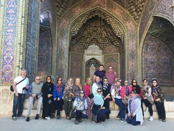 Travelers pose for a photo during their visits to the atmospheric Nasir al-Molk Mosque in Shiraz, southern Iran.