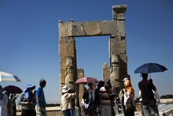 "Chinese tourists visit the ""Gate of All Nations"" at the ancient Persian city of Persepolis near Shiraz in southern Iran, which is hoping to dramatically increase the number of visitors from China with a new visa waiver program. (Photo: AFP)"