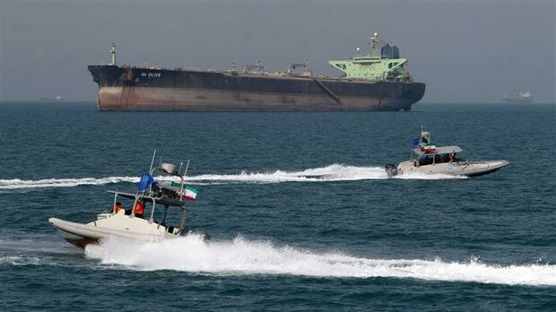In this file picture, Iranian speedboats drive in front of an oil tanker at the port of Bandar Abbas in the Persian Gulf. (Photo by AFP)