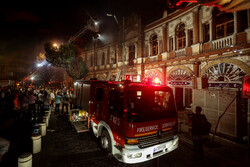 Fire burns down parts of historic buildings of Hassanabad Sq. in Tehran