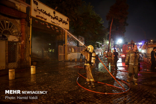 Fire burns down parts of historic buildings of Hassanabad Square in Tehran