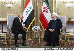 Iraqi Prime Minister Adel Abdul Mahdi talks with President Hassan Rouhani