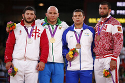 Iran NOC urges UWW to modify Komeil Ghasemi's medal