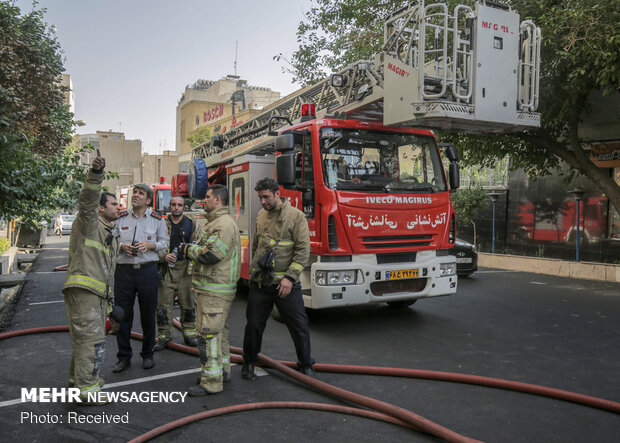 Firefighters extinguish warehouse fire in Tehran
