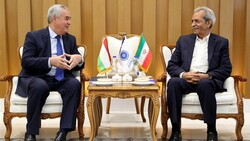 Tajikistan's new ambassador to Iran, Nizamuddin Zahedi (R), held talks with ICCIMA Head Gholam-Hossein Shafeie in Tehran on Thursday