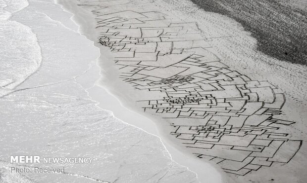 kum üzerinde resim