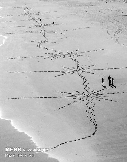 نقاشی روی شن های ساحل