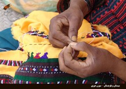 A woman completes a piece of needlework in Iran's Sistan-Baluchestan province