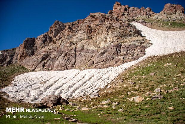 Climbing Buzsina mountain in summer