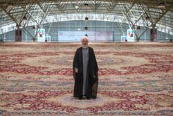 President Hassan Rouhani stands on a 600-square-meter handwoven carpet in an international carpet exhibit in Tabriz, August 1, 2019.