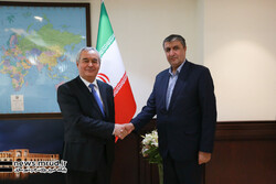 Tajikistan's ambassador to Iran, Nizamuddin Zahedi (L), held talks with Iranian Transport Minister Mohammad Eslami on Monday in Tehran