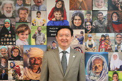 Chinese Ambassador to Iran Chang Hua poses for a photo during his visit to the Tehran-based Mehr news agency on August 6, 2019.