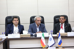 Nicaragua's Minister of Finance and Public Credit Ivan Acosta Montalvan (1stR) attended a meeting with the Head of Iran Chamber of Commerce, Industries, Mines and Agriculture (ICCIMA) Gholamhossein Shafeie (middle) in Tehran on Tuesday