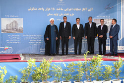 Iranian President Hassan Rouhani (1stL) and Minister of Transport and Urban Development Mohammad Eslami (2ndL) attended the opening ceremony of the National Action Plan for Construction and Supply of Housing in Tehran on Tuesday