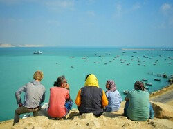 Vacationers enjoy a sea view during their visits to Chabahar, southern Iran