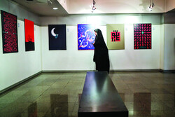 Art aficionado visits a poster exhibition on Ashura underway at the Abolfazl Aali Gallery of the Art Bureau in Tehran on September 1, 2019. (Mehr/Majid Asgaripur)
