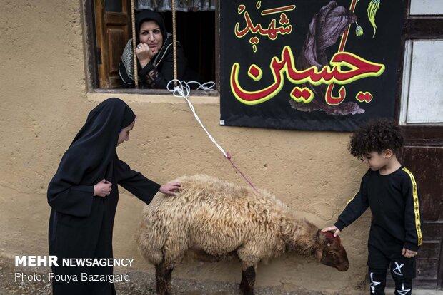 "Traditional Muharram mourning ceremony ""Alam Bandan"" in Masuleh"