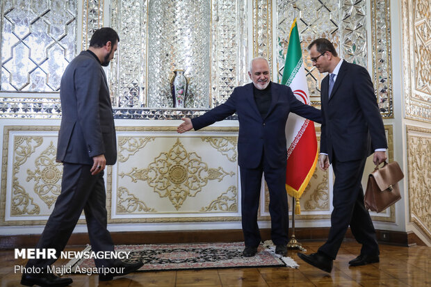 Head of UN nuclear watchdog, Iranian FM hold talks