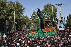 خمین میں عاشور کے دن تابوت اٹھانے کی تقریب