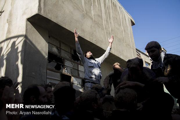 آیین «گِل مالی» مردم بیجار در عاشورای حسینی