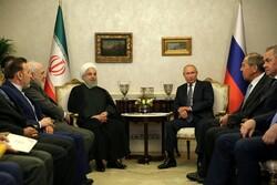 الرئيس روحاني يلتقي مع بوتين