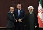 Iran, Russia, Turkey working to agree on date for Syria summit