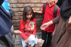 نجات کودک ۶ ساله از دل آتش و دود