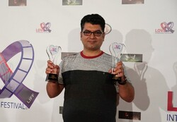 "Iranian director and producer Ali Atshani poses after accepting the best film award for his comedy ""Katyusha"" during the Love International Film Festival Santa Monica, CA in the U.S. on September 21,"