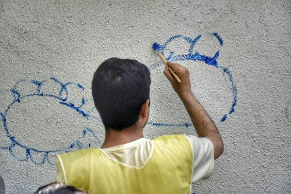 کودکان اوتیسم دیوارهای شهرمان را رنگی کردند