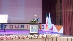 Iran's tourism minister Ali-Asghar Mounesan addresses guests during a national celebration to mark the World Tourism Day in Zahedan, the capital of southeastern Sistan-Baluchestan province, September 28, 2019.