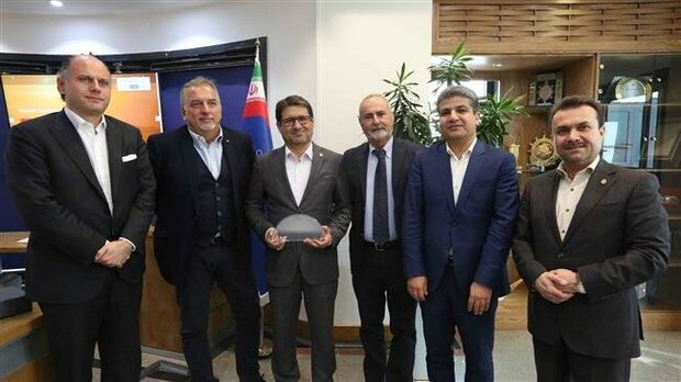 PMO Head Mohammad Rastad (C) posing for a picture with members of a visiting Italian maritime delegation in Tehran on September 29, 2019