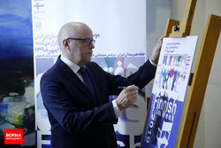 Finish Ambassador Keijo Norvanto autographs a poster for the Finnish Film Week during the opening ceremony of the event at the Iranian Artists Forum in Tehran on September 28, 2019. (Borna/Matin Qasem