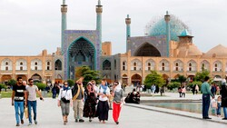 Tourists visit the UNESCO-registered Imam Square (originally named as Naqsh-e Jahan Square) in Isfahan, central Iran, April 12, 2018.