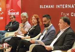 Farabi Managing Director Alireza Tabesth (R) and a number of film experts and cineastes attend a panel discussion during the 4th Slemani International Film Festival in Sulaymaniyah, Iraq on October 5,